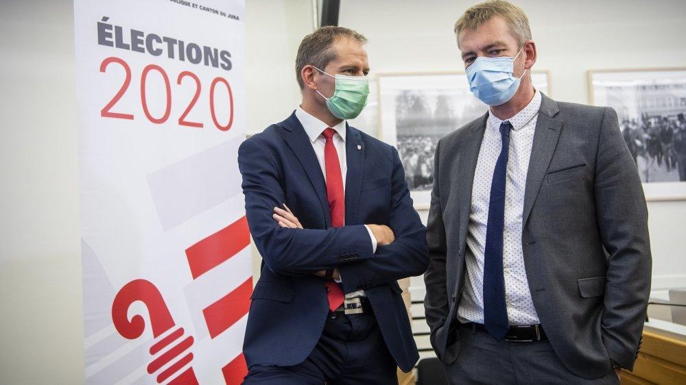 Le ministre David Eray, candidat au Gouvernement jurassien pour le PCSI (à gauche), avec le candidat PDC Stéphane Babey.