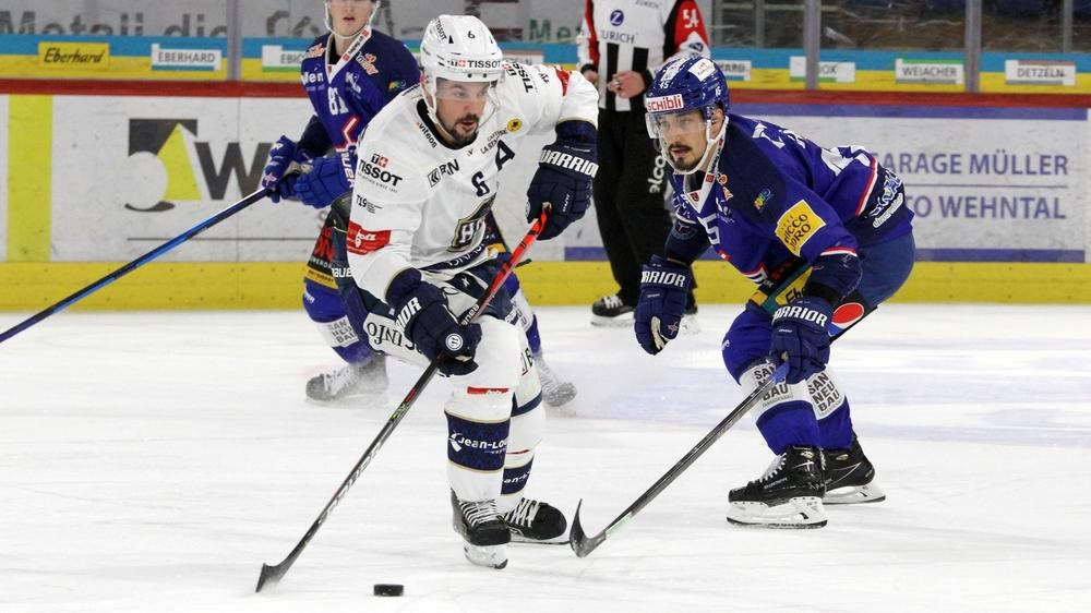 Tim Coffman (en blanc) et le HCC ont joué un bien mauvais tour à Kloten (ici Jorden Gähler).