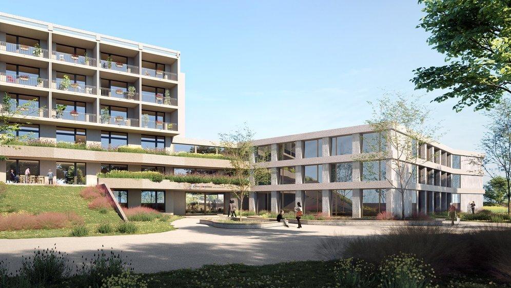 A gauche, le bâtiment existant. A droite, la future annexe.