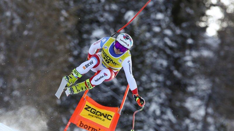 Urs Kryenbuehl monte sur le podium de la descente de Bormio.
