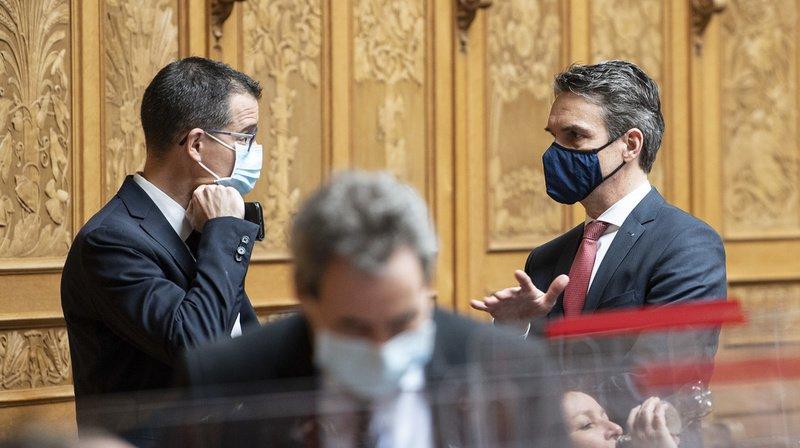 Pour le député Marco Romando (Centre/Ti), à droite), rien ne s'oppose à l'introduction du projet en Suisse.
