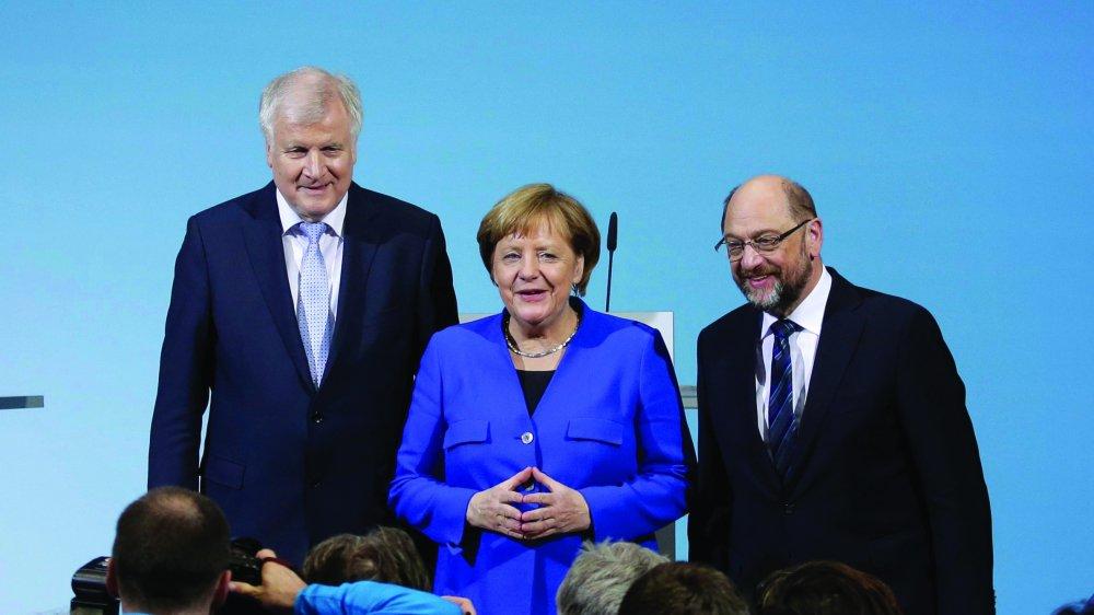 Horst Seehofer (à gauche, CSU), Angela Merkel (CDU) et Martin Schulz (SPD) ont présenté, hier, un accord de principe entre leurs trois partis.  Ce texte détaille ce à quoi pourrait ressembler le programme d'une nouvelle «grande coalition».