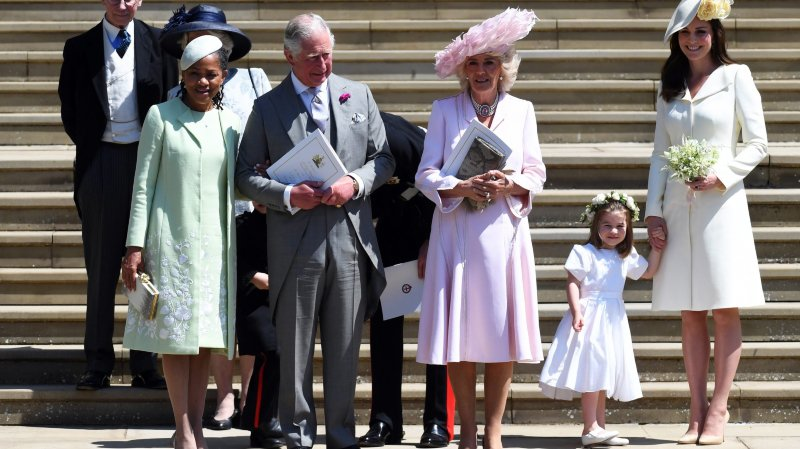 epa06749751 Meghan's mother Doria Ragland (L), Britain's Prince Charles (2-L), Camilla (C) the Duchess of Cornwall, Catherine (R), Duchess of Cambridge and Princess Charlotte (2-R) leave St George's Chapel in Windsor Castle after the royal wedding ceremony of Prince Harry, Duke of Sussex and Meghan, Duchess of Sussex in Windsor, Britain, 19 May 2018. The couple have been bestowed the royal titles of Duke and Duchess of Sussex on them by the British monarch.  EPA/NEIL HALL / POOL