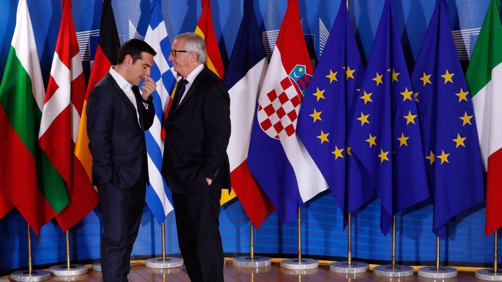 Le premier ministre grec, Alexis Tsipras, et le président de la Commission européenne, Jean-Claude Juncker, en pleine réflexion:  la crise des migrants représente un véritable casse-tête pour l'Europe.