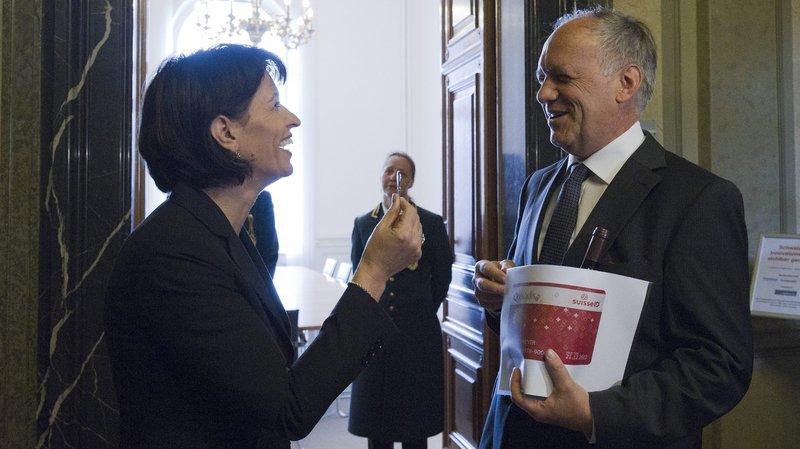 Doris Leuthard et Johann Schneider Amman, le second a annoncé sa démission du Conseil fédérale. La première pourrait suivre la voie.