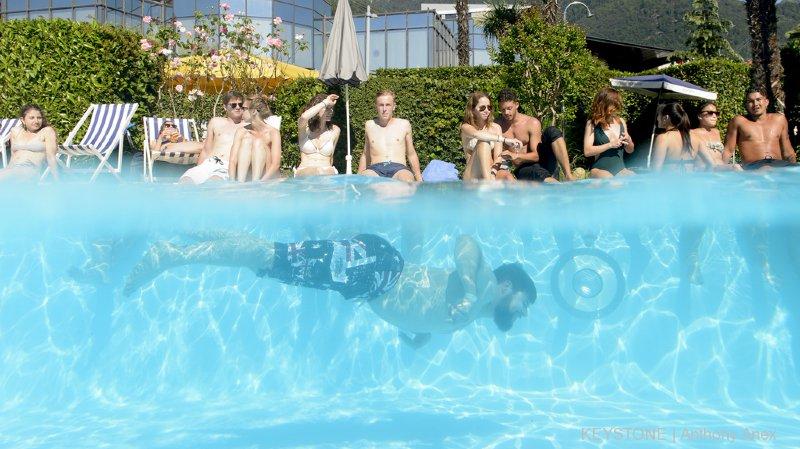 Canicule: les piscines romandes font le plein, sans pour autant battre des records