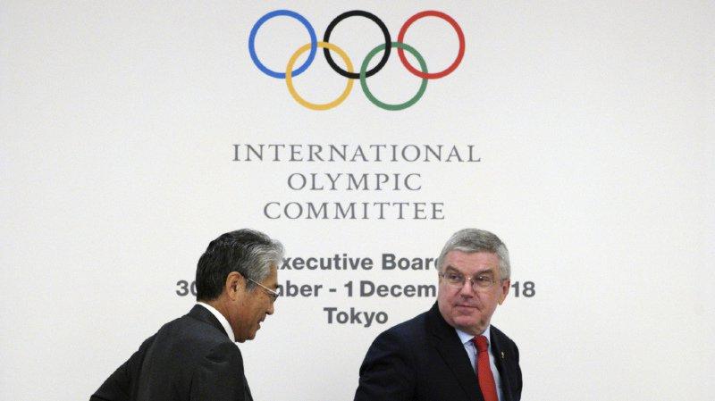 En décembre, la justice française a mis en examen le président du comité olympique japonais Tsunekazu Takeda, à gauche sur la photo. (Archives)