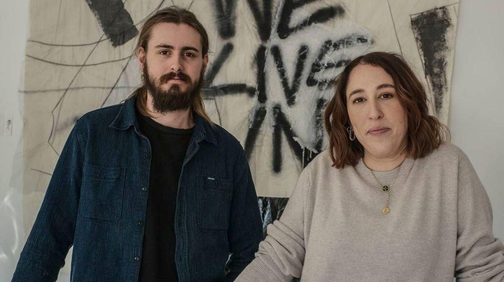 """Elliott Brighton et Jeanne Guenat dans leur atelier aux Bois, où naissent les modèles de leur marque baptisée """"Sottes""""."""