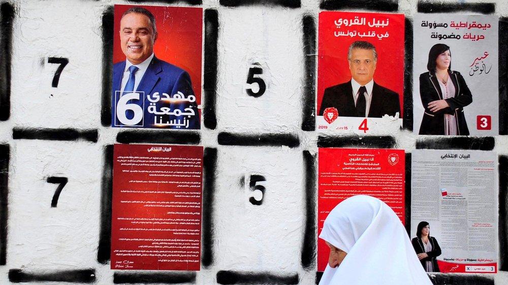Un mur d'affichage des candidats à l'élection présidentielle, le 4 septembre, à Tunis.