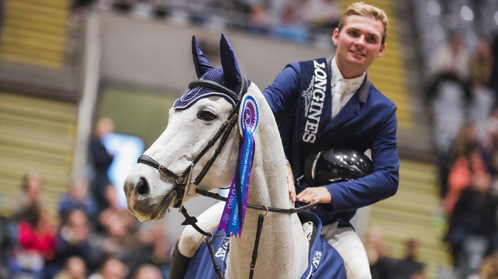 """Bryan Balsiger lors de son triomphe à Oslo, sur son cheval """"Clouzot de Lassus""""."""