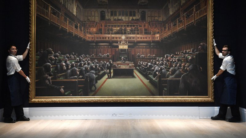 Peinture: un tableau de Banksy adjugé 12,2 millions de francs, un record