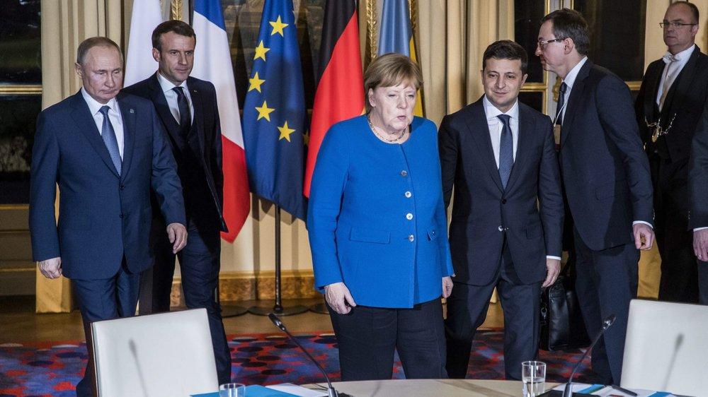 C'est sous l'égide d'Emmanuel Macron et Angela Merkel que le Russe Vladimir Poutine (tout à gauche) et l'Ukrainien Volodymyr Zelenski (tout à droite) se sont réunis pour tenter de réchauffer un peu les relations entre leurs deux pays.