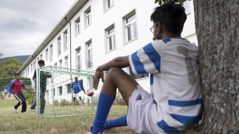 Migration: feu vert du Parlement à trois nouveaux centres d'asile en Suisse