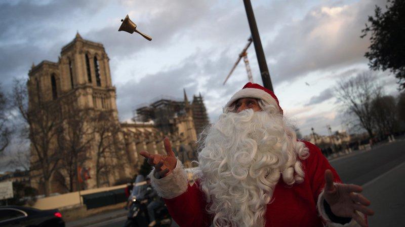"""L'ambiance était """"lourde"""" à Paris pour le premier Noël sans Notre-Dame. (Illustration)"""