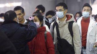 Coronavirus: face à l'épidémie, la Chine confine des villes entières, le monde se prépare