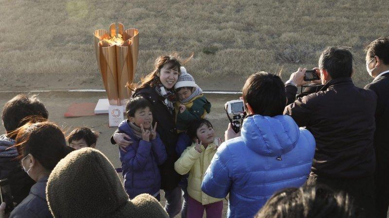 La flamme olympique arrive au Japon en catimini