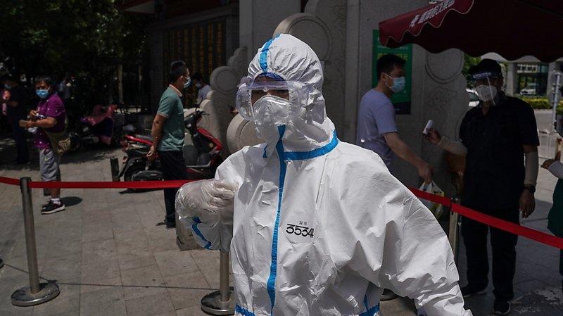 Coronavirus: en alerte après de nouveaux cas, Pékin referme ses sites culturels et sportifs