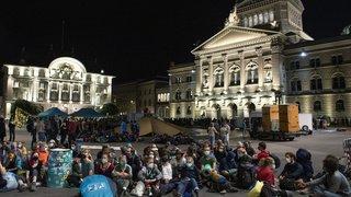 Climat: des activistes occupent la Place fédérale à Berne